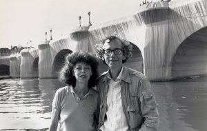 Christo and Jeanne-Claude at The Pont Neuf Wrapped (1975–85) in 1985. Photo: Wolfgang Volz; © Christo